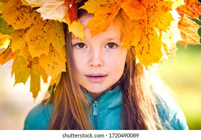 Portrait of a girl with autumn leaves