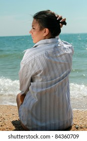 Portrait of a girl from the back sitting on the beach