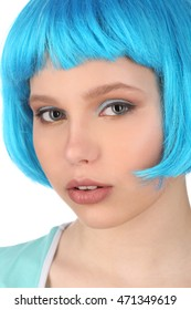 Portrait of girl with blue hair. Close up. White background