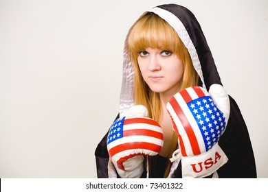 Portrait of a girl boxer on a white background