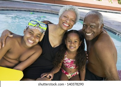 Portrait of a girl and boy with grandparents by the swimming pool