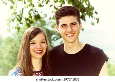 Portrait of a girl and boy in nature