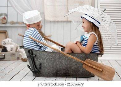 Portrait of a girl and a boy sailors playing in his room