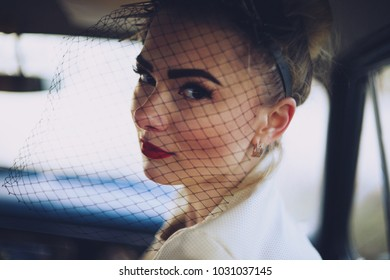 A portrait of girl is in a car