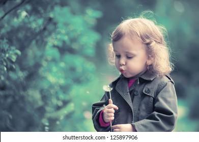 portrait girl  child with dandelion