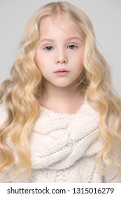 Portrait of a girl close-up, long blond hair. Blue eyes,