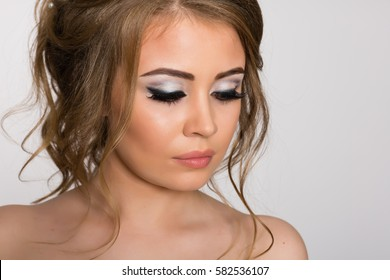Portrait of a girl close-up with trendy makeup