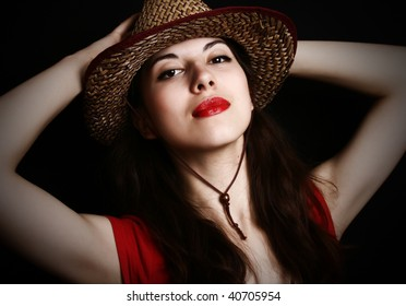 Portrait of the girl in clothes of the cowboy.