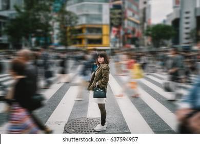 Portrait girl crossing busy city street/ Girl Crossing Street/ Girl crossing street in Tokyo, Japan