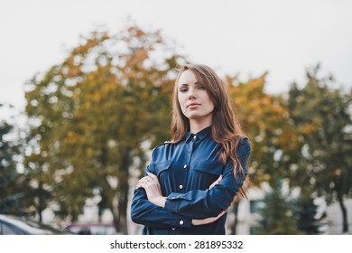 Portrait of the girl in a dark blue shirt.