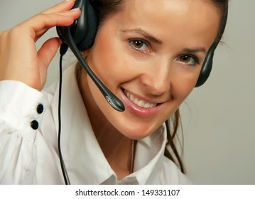 Portrait of a girl with dark hair in headphones