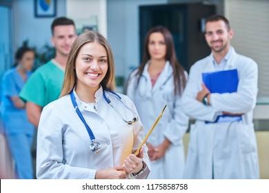 Portrait girl dentist,students in background