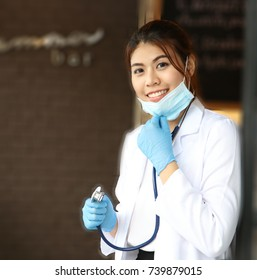 Portrait of a girl doctor in a mask,phonendoscope