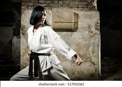 Portrait of a girl doing karate exercise. Martial arts.
