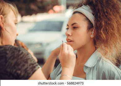 portrait of a girl doing makeup