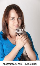 Portrait of the girl with a domestic polecat