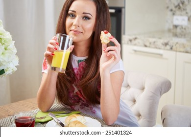 Portrait of a girl eating breakfast in an apartment