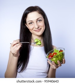 Portrait of a girl eating salad
