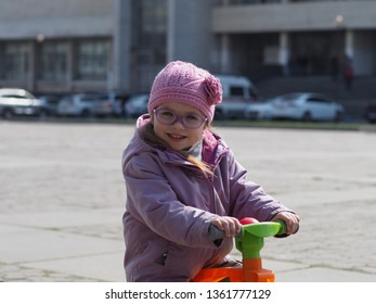 4b3dd4cd98578 portrait of a girl of European appearance 3.5 years in a lilac jacket  knitted hats and
