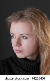 Portrait of the girl with a fair hair on a black background