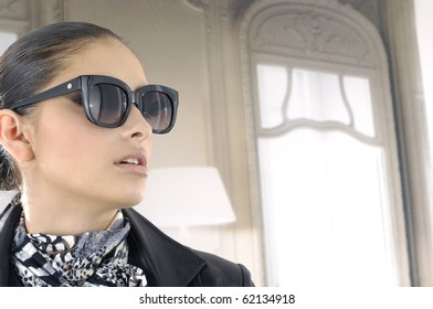 Portrait of girl in fashion dress wearing sunglasses
