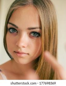 Portrait of a girl. Feminine look. Beautiful young blonde in studio.