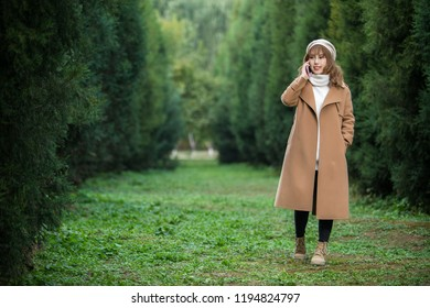 Portrait of a girl in forest using cellphone