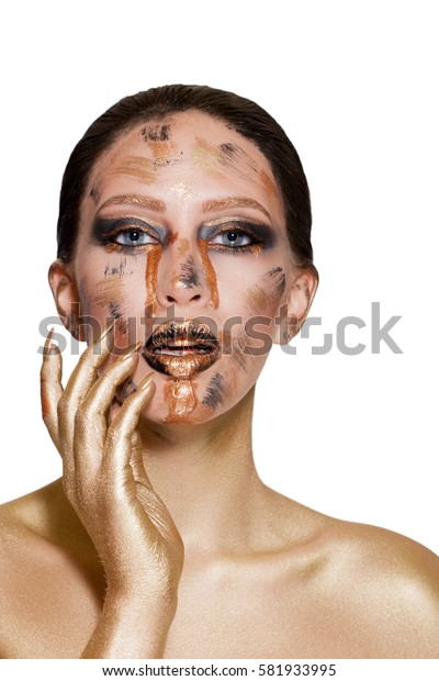 portrait of a girl with golden makeup, fantasy makeup. black lips with gold. Portrait of a young woman close-up woman with make-up on her face