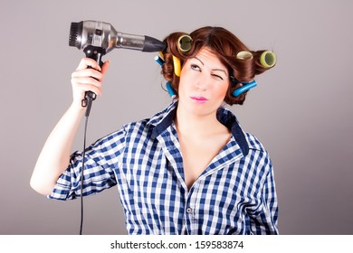 portrait of a girl with hair blower