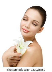Portrait of girl handing white lily with eyes closed, isolated on white. Concept of natural beauty and youth