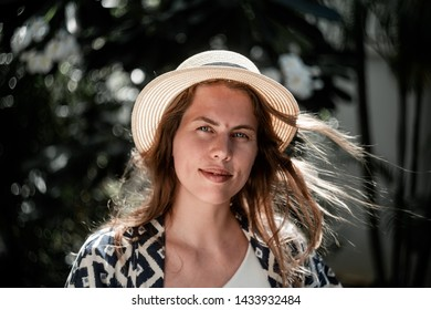 Portrait of a girl with a hat