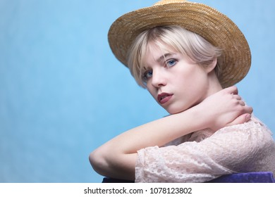 Portrait of girl in hat on blue background