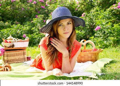 Portrait of a girl in a hat on a picnic