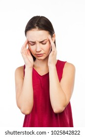 Portrait of a girl having a headache or looking stressed, isolated on white