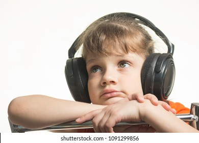 Portrait of a girl in headphones listening to music musically