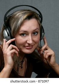 Portrait of the girl in the headphones, listening to music.