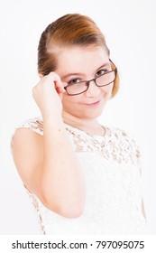 Portrait of girl holding glasses on white