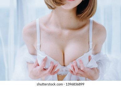 Portrait of a girl holding her breast.