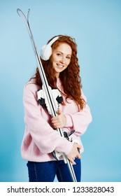 Portrait of girl holding her skis