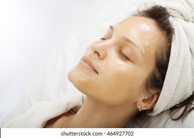 portrait of girl with a honey facialmask close up