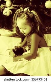 Portrait of a girl hugging a rabbit