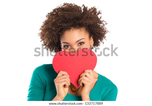Portrait Of Girl Isolated Holding a Paper Heart Over White Background