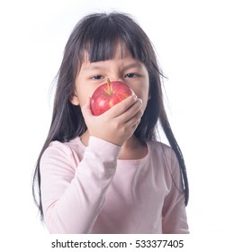 portrait of a girl kid bit ting a red apple on white background