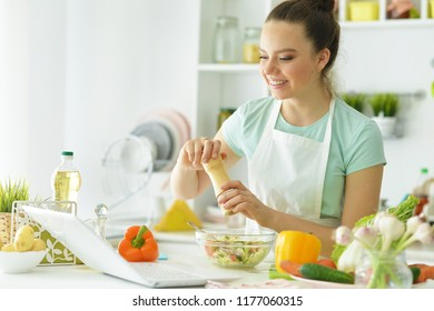 Portrait of girl in the kitchen cook