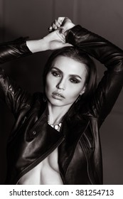 Portrait girl in leather jacket, make-up smoky eyes. wet hair