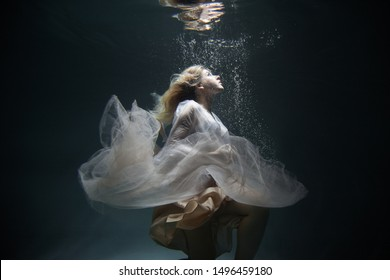 portrait of a girl with long hair underwater