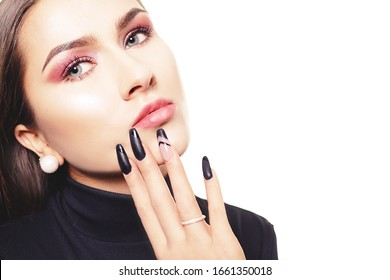 Portrait of a girl with long nails, close-up of a girl with pink shadows, professional eyebrows. Beautiful eyebrows. Girl with professional make-up.