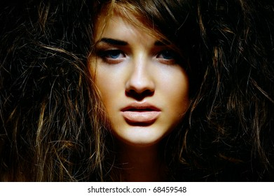 Portrait of the girl with a mad hairdress