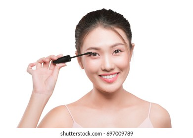 Portrait of a girl with a make-up brush for lash in hands isolated on white