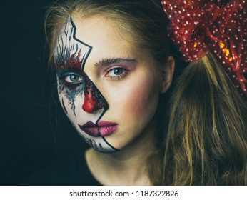 Portrait of a girl in makeup. Halloween, the face of a girl is a doll, the floor of a face is dead.